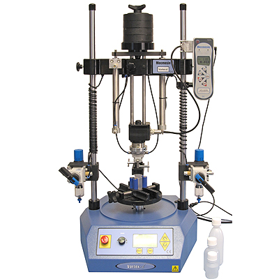 Efficient testing is facilitated by this pneumatic sample lifing mechanism