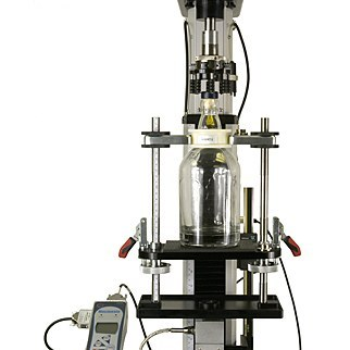 Pneumatic fixtures grip the glass bottle for cork extraction testing
