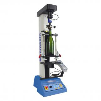 A test sytstem to accurately simulate cork extraction must pull and twist the closure